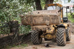 Bulldozer Standing on Site. A Bulldozer is seen standing on a residential construction site after the work is over. Upper Minsk is a well developed city and is royalty free stock image
