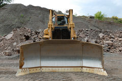 Bulldozer in a stone pit Royalty Free Stock Photo