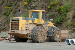 Bulldozer in a stone pit Royalty Free Stock Photography
