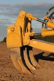 Bulldozer tines. 'Boot rippers' in late afternoon light stock images