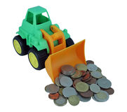 Bulldozer toy. Kids plastic bulldozer toy and coins. Financial security stock photo