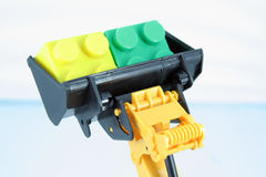 Bulldozer toy. And some blocks. Kids toys royalty free stock images
