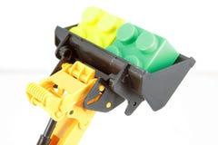 Bulldozer toy. And some blocks. Kids toys Stock Photos