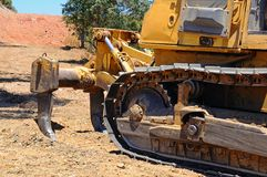 Bulldozer tracks and ripper tool. Stock Image