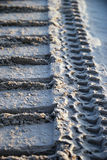Bulldozer tracks in sand Stock Photo