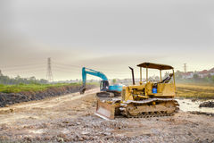 Bulldozer and tractor Stock Photography