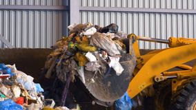 Bulldozer, tractor pushes a pile of trash at landfill. 4K stock footage