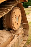 Bulldozer Tread. Covered in dirt royalty free stock images