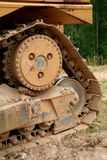 Bulldozer tread. Covered in dirt stock photos