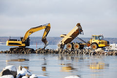 Bulldozer and truck in dredging works Stock Photography