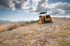 Bulldozer in a Tuscan hill.  Royalty Free Stock Images