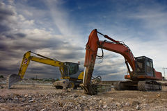 Bulldozer twins. Two bulldozers parked in a blowned building Stock Photography