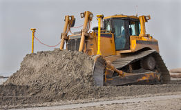 Bulldozer up close. Big Bulldozer at work on a beach stock photos