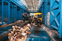 The bulldozer will clean the waste dump. Waste processing plant. Technological process. Business for sorting and. Processing waste Stock Images