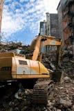 Bulldozer at work. Bulldozer while working on piles of rubble stock image