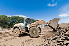 Bulldozer at work shifts of cast iron Stock Photography