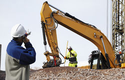 Bulldozer and workers in action Royalty Free Stock Photography