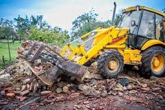 Bulldozer working at demolition site Stock Photo