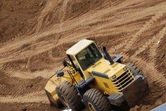 Bulldozer working in sand dunes stock photo