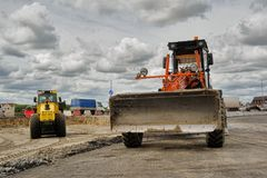 Bulldozer works on road construction in Tyumen. Tyumen, Russia - June 1, 2017: JSC Mostostroy-11. Construction of two-level outcome on bypass road on Stock Photography