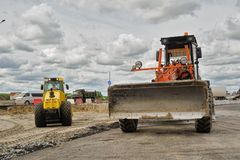 Bulldozer works on road construction in Tyumen Royalty Free Stock Photo