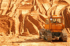 Bulldozer at worksite. Little yellow bulldozer at worksite Stock Images