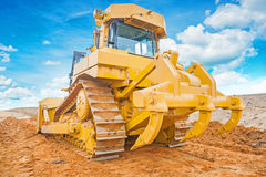 Bulldozer yellow colored standing on sand rear Stock Photography