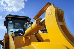Bulldozer yellow scoop stock images
