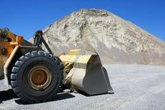 Bulldozer in zand-kuil stock afbeelding