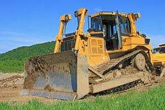 Bulldozeren på en byggnadslokal Fotografering för Bildbyråer