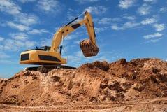 bulldozergrävskopasandlåda Arkivfoton