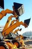 Bulldozers. In a construction site stock photos