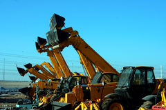 Bulldozers. Lined up in a contruction site stock photos