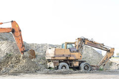 Bulldozers on construction site against clear sky Stock Images