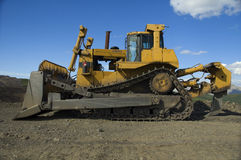 Bulldozers lateral. Side view of a Bulldozers Coal Opencast, with chains royalty free stock images