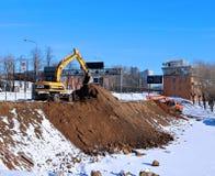 Bulldozers make the mound, doing ground works Royalty Free Stock Photo