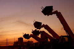 Bulldozers at the sunset. Bulldozers on rest due to recession in the contruction industry stock photos