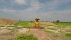 Bulldozers Tractors. Tractors Bulldozers flatten the area stock footage