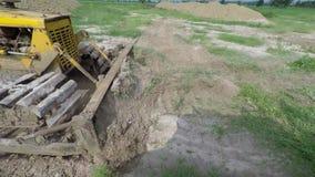 Bulldozers Tractors. Tractors Bulldozers flatten the area stock video