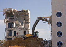 Bulldozers work. Destruction of a building Stock Photography