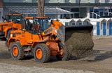 Bulldozers at Work on a Beach Royalty Free Stock Photography