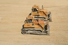 Bulldozers on working area Royalty Free Stock Photos