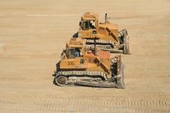 Bulldozers on working area. Two bulldozers on working area Royalty Free Stock Photos
