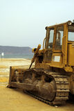 Bulldozing the beach Stock Images