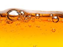 Bulles dans le savon liquide orange Photos libres de droits