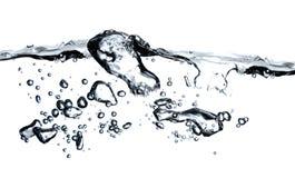 Bulles dans une eau Photographie stock