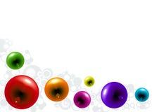 Bulles en verre de couleur sur un fond blanc Photo stock