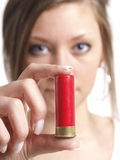 Bullet. Girl is holding a bullet on white background Stock Images