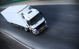 Bullet. White truck on a road - see other trucks in my portfolio Royalty Free Stock Photography