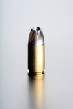 Bullet 9mm. One silvertip round closeup with limited dof - focus on tip, brushed metal background Stock Image
